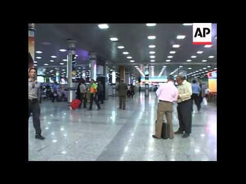 Worried passengers at airport watch news of Caspian Airlines crash