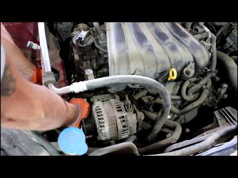 Замена натяжителя приводного ремня на Nissan Qashqai 2,0 4WD Ниссан Кашкай 2007 года
