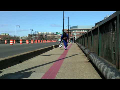 Globetrotter dribbles down Freedom Trail and Charlestown Bridge in Boston