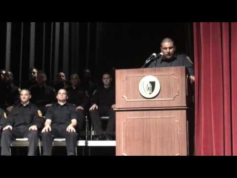 Mohammed Khan - the first ever Pakistani-American Fire Fighter in Bridgeport History - speaks to fellow graduates of the Connecticut State Fire Academy at a ceremony in New Britain on Friday, Dec. 9.