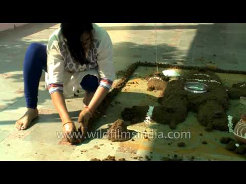 Govardhan Puja - Woman makes cow dung hillock to symbolize Mount Govardhan