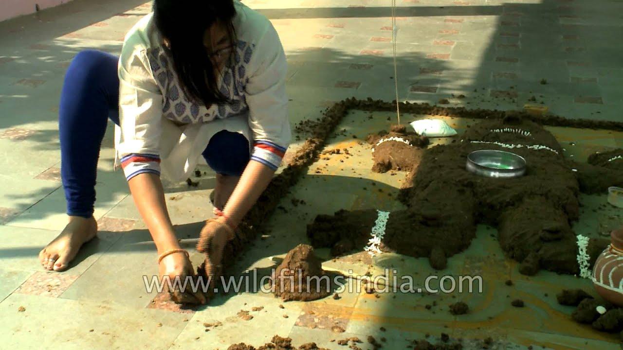 Govardhan Puja – Woman makes cow dung hillock to symbolize Mount Govardhan