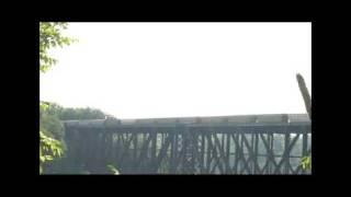 Long Covered Hopper Train Crossing High Bridge.