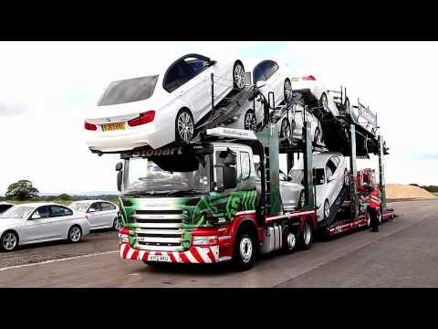 Loading Eddie Stobart Transporter with 11 brand new BMWs