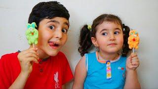 Celina gives Hasouna Food toy - سيلينا وحسونة طعام غير حقيقي