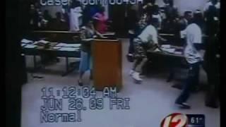 Smiling Murder Suspect Sparks Courtroom Brawl