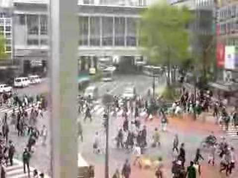 People crossing streets at Shibuya station in Tokyo