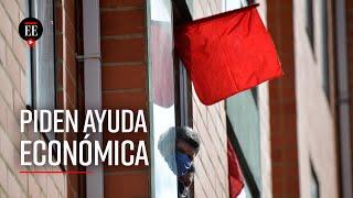 Trapos rojos para pedir ayuda económica en Colombia ante la pandemia del coronavirus - El Espectador