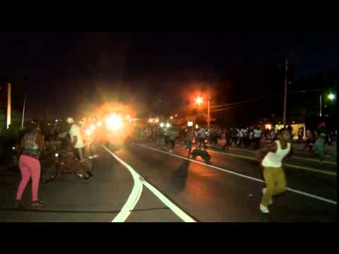 Tear gas in Ferguson as protesters clash with police