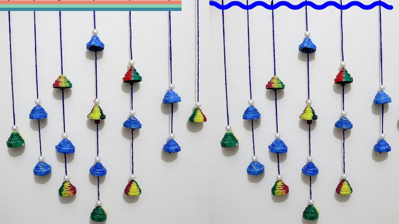 Newspaper wall hanging newspaper wind chime best out for Best out of waste wall hanging ideas