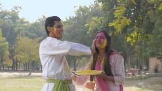 Young happy friends coloring each other with Gulal on the joyful festival of Holi