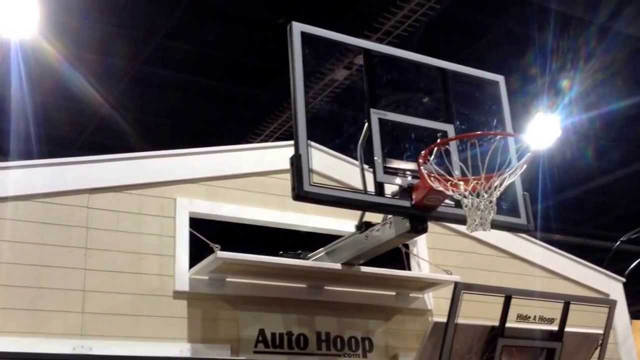 Auto hoop fold away basketball hoop youtube for Basketball garage