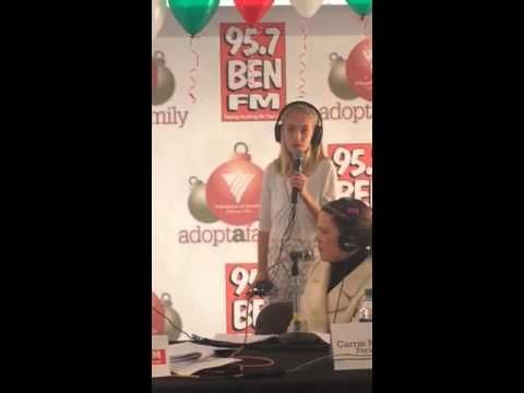 Avery sings I Saw Mommy Kissing Santa Claus with 95.7 BEN-FM Adopt-A-Family Radiothon