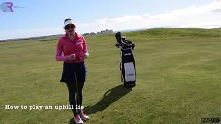 How to strike the ball on an uphill lie