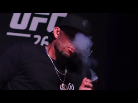 Nate Diaz throws JOINT to crowd and offers Moreno a PUFF