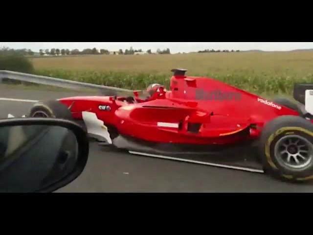 Insane footage! F1 car ( is it a Ferrari !? ) on public highway!