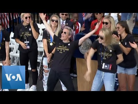 U.S. Women Soccer Team Cheered By Fans During New York City Victory Parade