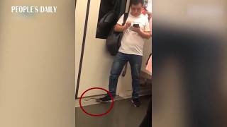 Running rat got stomped on by a poised commuter on the subway in Shanghai.
