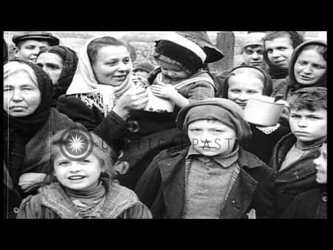 Children and old people eat food at a bread line in Prague, not long after the en...HD Stock Footage