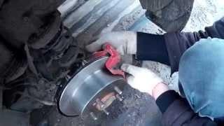 замена задних тормозных колодок  и дисков на KIA Cerato 2009 г.в