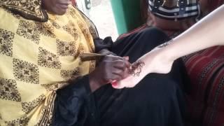 Sudan woman making natural henna tattoo