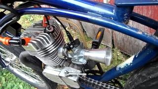 Close up of the twin ignition motorized bicycle engine running