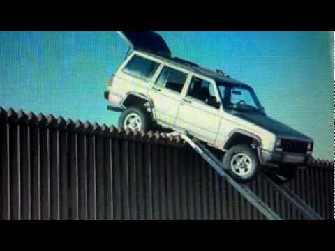 Drug Smugglers Jeep Stuck On Mexico Border Fence