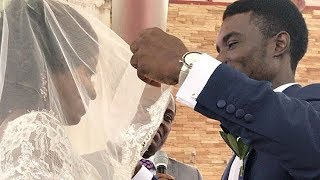 Groom Lifts Bride's Veil And Celebrates