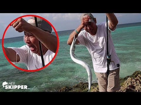 AGGRESSIVE FISH BITES MY DAD WHILE BEACH FISHING!!
