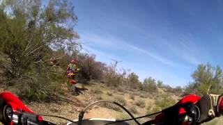 2 12 year old boys and a 14 year old girl hitting some single track