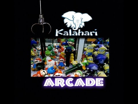 Playing the Claw Machines + Other Games at Kalahari's Arcade!