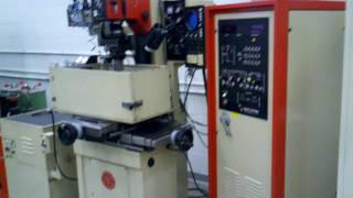 edm burning process on machinist vise