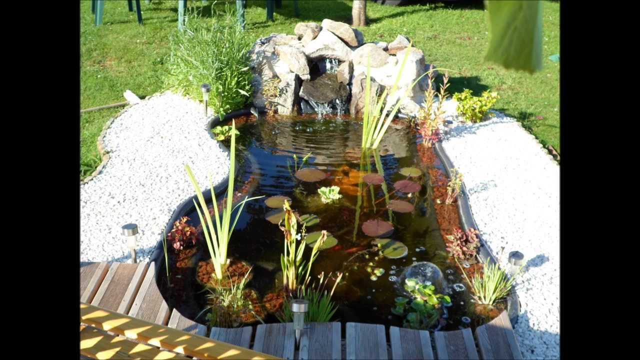 Bassin de jardin youtube for Bassin a poisson preforme