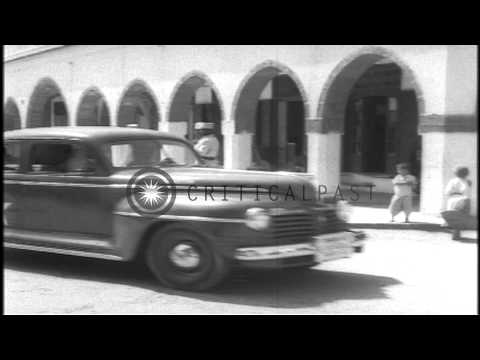 Madame Chiang Kai-shek is greeted by a US officer and enters a car in North Afric...HD Stock Footage