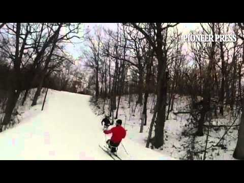 US Paralympic Nordic skiers Aaron Pike, in red, and Andy Soule, training in the Twin Cities for a wo