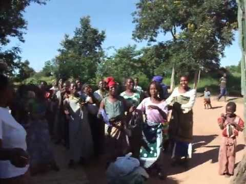 Clients in Malawi Perform Welcoming Song and Dance