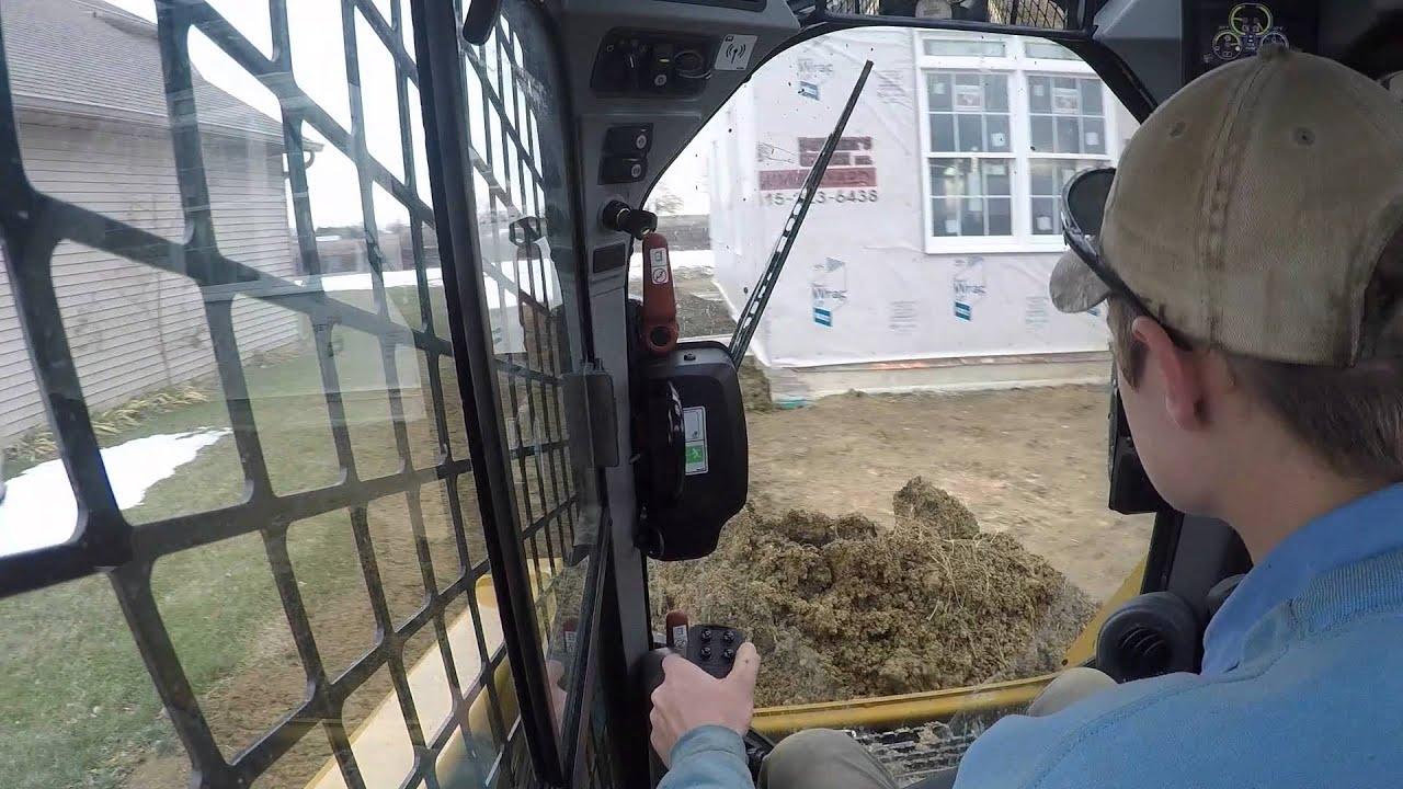 Cat 239D backfilling foundation