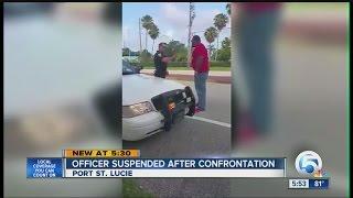 Officer suspended after confrontation