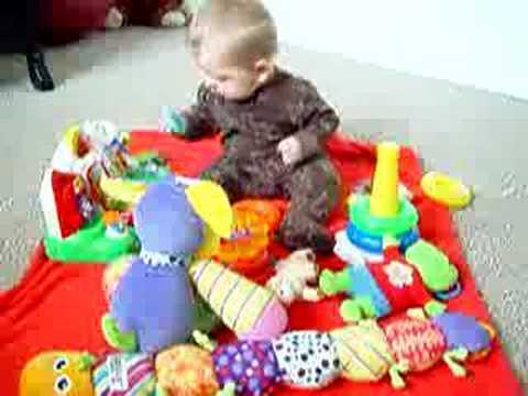6 Month Old Baby Babbling And Playing With Toys