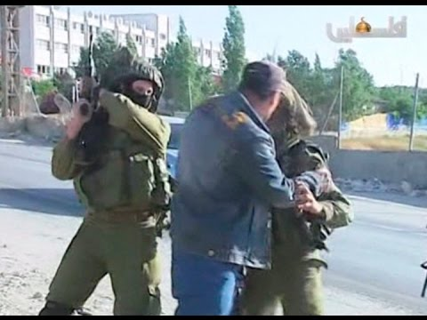 Israeli soldairs filmed beating unarmed palestinian during w