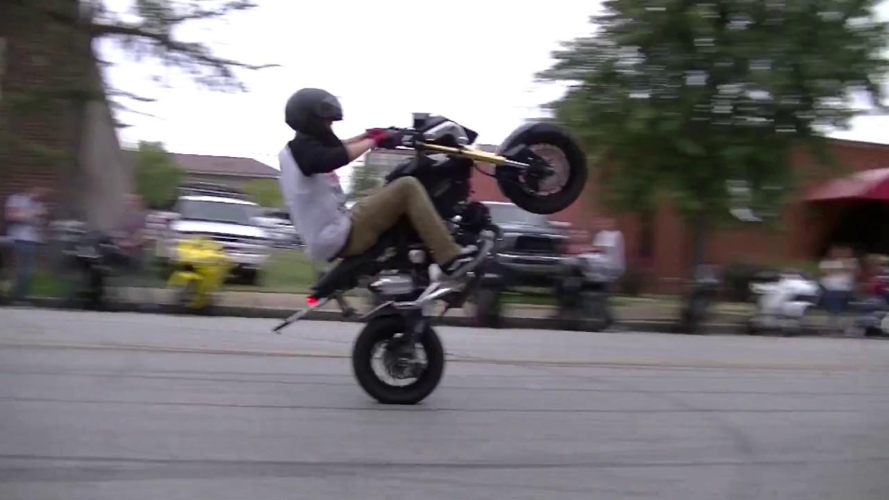 Kid Stunts A Black 2015 Honda Grom Stand Up And Sit Down Wheelies
