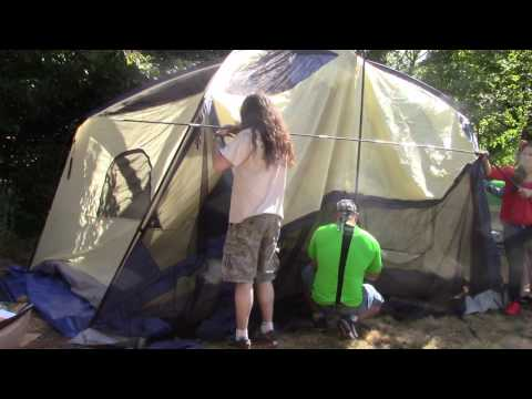 SETTING UP OZARK TRAIL 12 - PERSON CABIN TENT WITH SCREEN PORCH