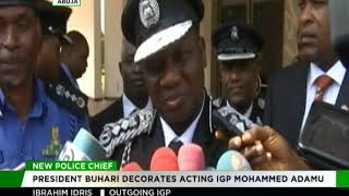 President Muhammadu Buhari decorates new IGP Muhammed Adamu
