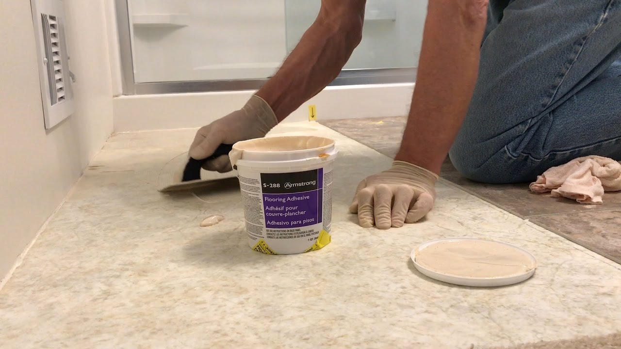 luxury vinyl tile installation step 3 spread the adhesive