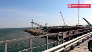 Проезд по технологическому мосту между косой Тузла и берегом Тамани(Недавно завершено строительство первого участка технологического моста через Керченский пролив, который..., 2015-10-08T12:32:22.000Z)