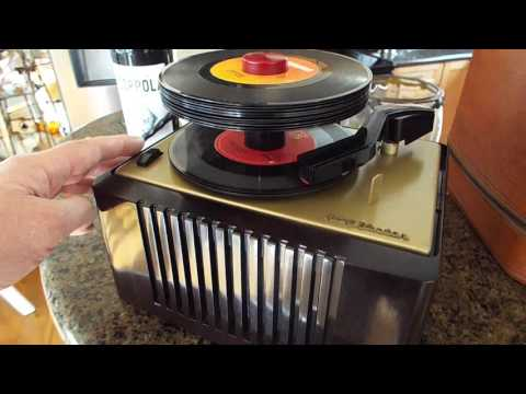 RCA record player.  With case.  Playing stack of 45 RPM records