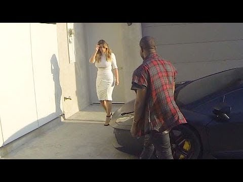 Kim Kardashian Shows Off Her Wicked Curves In A Figure-Hugging White Dress [2013] thumbnail