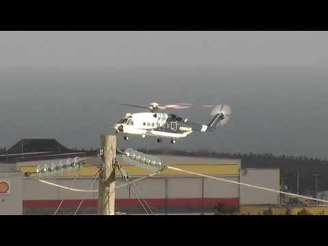 Sikorsky S92 helicopter hover and landing - camera 2 miles away