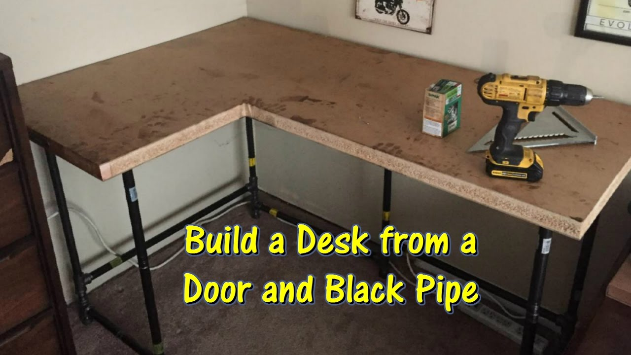 Build A Desk Using An Old Door And Black Pipe By Gettkdone