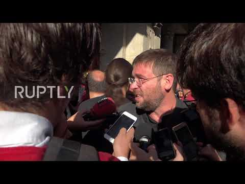 Spain: 'We want a vote!' Catalan protesters rally in Barcelona following arrest of officials